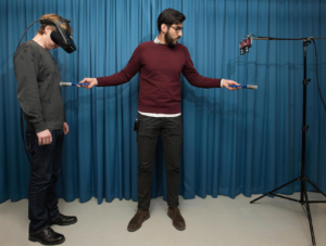 two men using oculus rift
